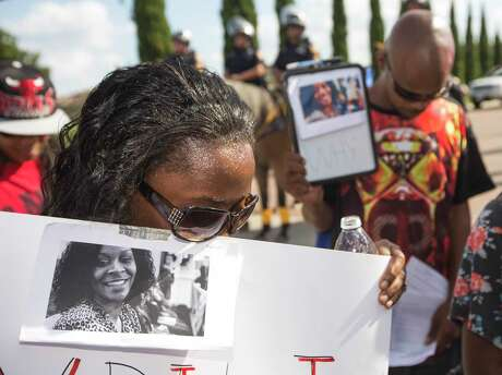 In this July 26, 2015 file photo, Margaret Hilaire bows her head in prayer during a demonstration following the suicide of Sandra Bland, who was found dead in her cell in the Waller County Jail, just days after being arrested during a traffic stop.