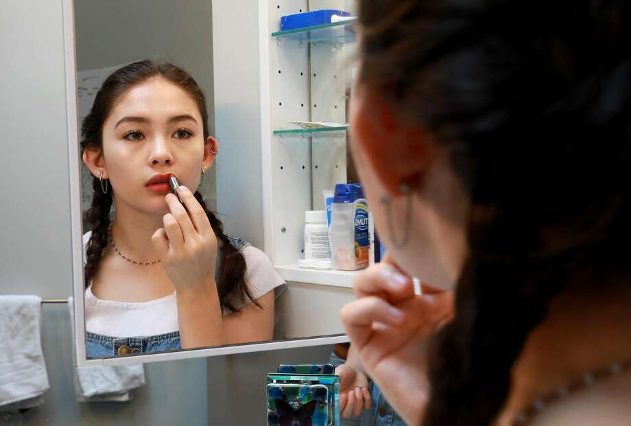ASMR artist Eve Donnelly, 17, applies lipstick in her bathroom before shooting a video for her audience. Eve has been shooting ASMR (autonomous sensory meridian response) videos since December. Photo: Yalonda M. James / The Chronicle