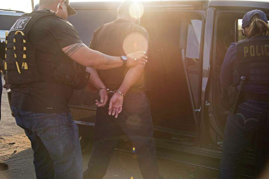 A raid by agents from U.S. Immigration and Customs Enforcement in Riverside, Calif., June 22, 2017. A message from the president this week promising millions of deportations has unnerved immigrant communities across the country. Photo: MELISSA LYTTLE /NYT / NYTNS