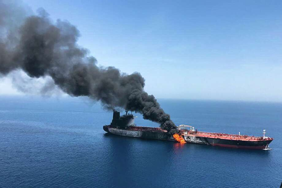 An oil tanker is on fire in the Gulf of Oman, June 13. A series of attacks on oil tankers near the Persian Gulf has ratcheted up tensions between the U.S. and Iran. Professor Richard Cherwitz compared of the oil tanker fires and the Gulf of Tonkin crisis in an intellectual theory application. Cherwitz is retiring from the University of Texas at Austin. Photo: /Associated Press / Iranian Students' News Agency, ISNA