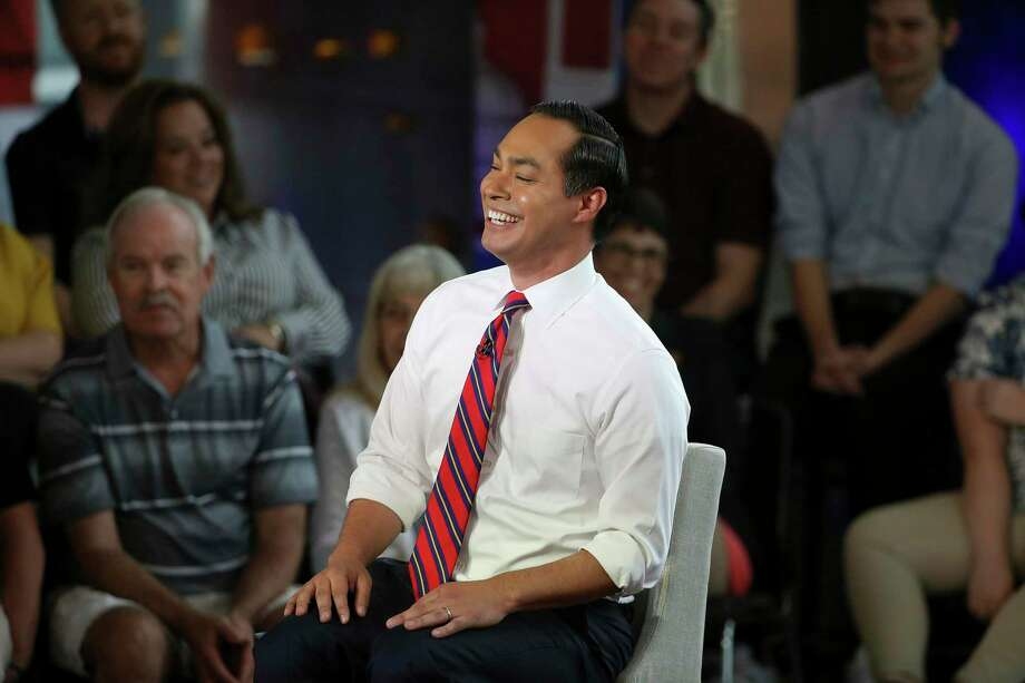 Democratic presidential candidate Julián Castro reacts with the audience during a town hall June 13 in Tempe, Ariz. Castro doesn't focus on getting on TV, but on releasing details on what he would do if elected and connecting with voters. Photo: Ross D. Franklin / Associated Press / Copyright 2019 The Associated Press. All rights reserved.