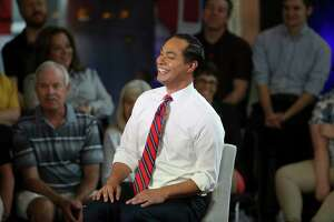 Democratic presidential candidate Julián Castro reacts with the audience during a town hall June 13 in Tempe, Ariz. Castro doesn't focus on getting on TV, but on releasing details on what he would do if elected and connecting with voters.
