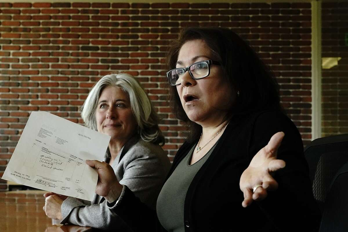 Lili Ortiz, right, of the Oakland Unified School District, was placed on administrative leave after questioning payments at her school. At left is her lawyer Judith Wolff on Friday, May 31, 2019, in Oakland, CA.