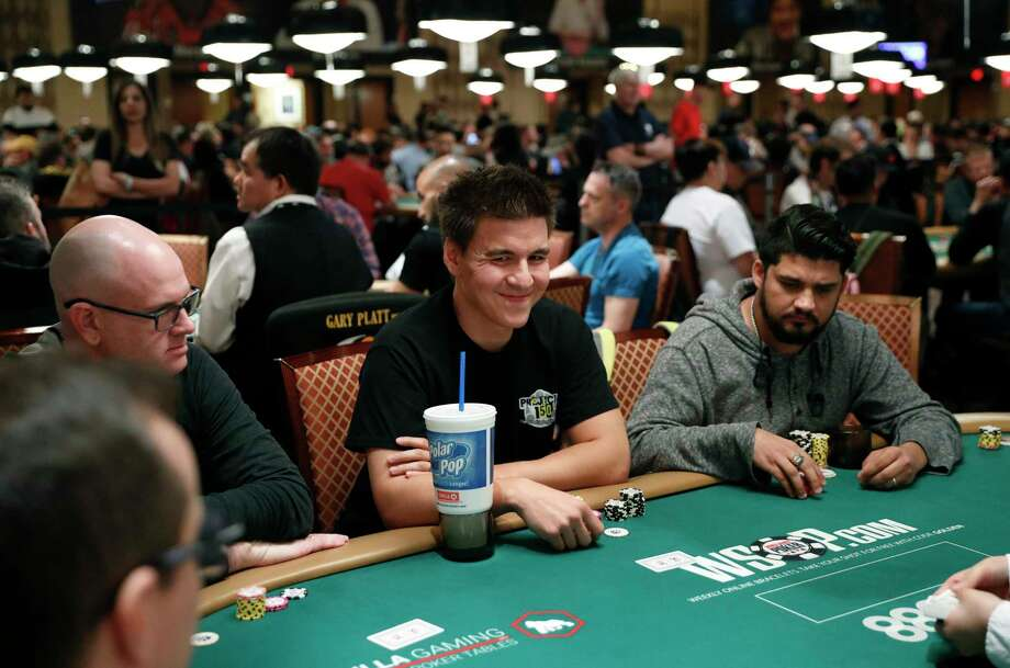 """Jeopardy!"" champion and professional sports gambler James Holzhauer, center, plays in a tournament at the World Series of Poker, Monday, June 24, 2019, in Las Vegas. Photo: John Locher, AP / Copyright 2019 The Associated Press. All rights reserved."