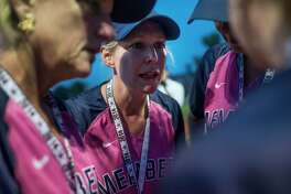 Women lawmakers led by Senator Kirsten Gillibrand, D-NY, huddle during the Congressional Softball game played in Washington in 2014.