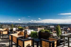 Calling all in search of views and brews, because we've uncovered eight of Seattle's best rooftops for a post-work drink. Here, the recently-opened Mountaineering Club in the University of Washington district gazes upon the Cascade mountains.