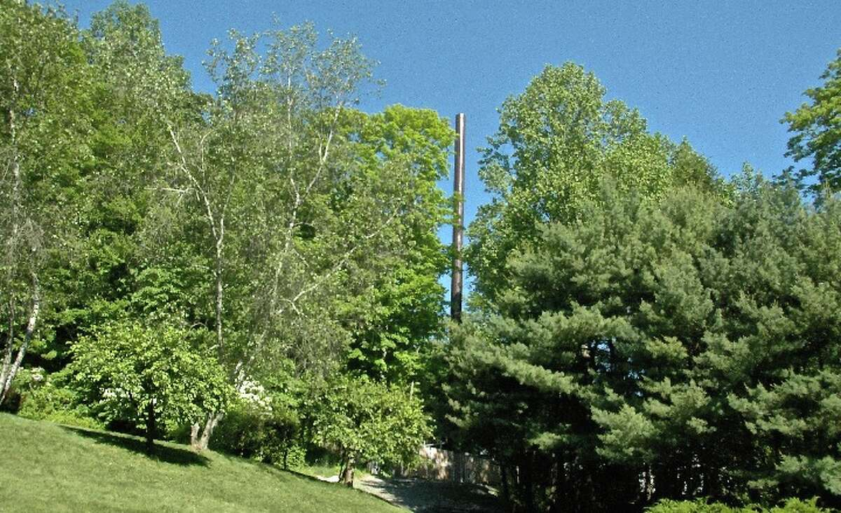 This monopole cell tower on private property belonging to Silver Hill Hospital, has antennas mounted internally. This is the Town's sixth preference out of a list of 16 options. - Casey Gertsen photo