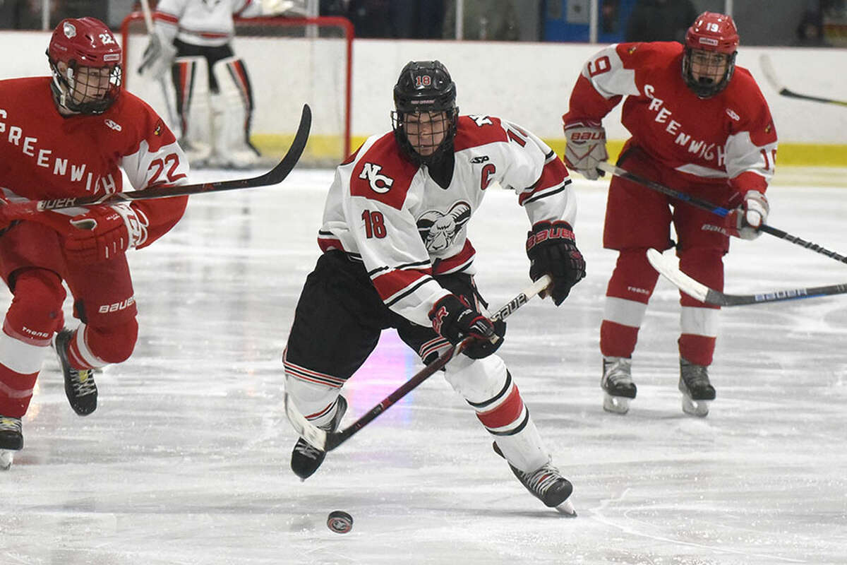 New Canaan's Gunnar Granito skates up the ice during a boys ice hockey game at the Darien Ice House on Monday, Feb. 4. - Dave Stewart/Hearst Connecticut Media photo
