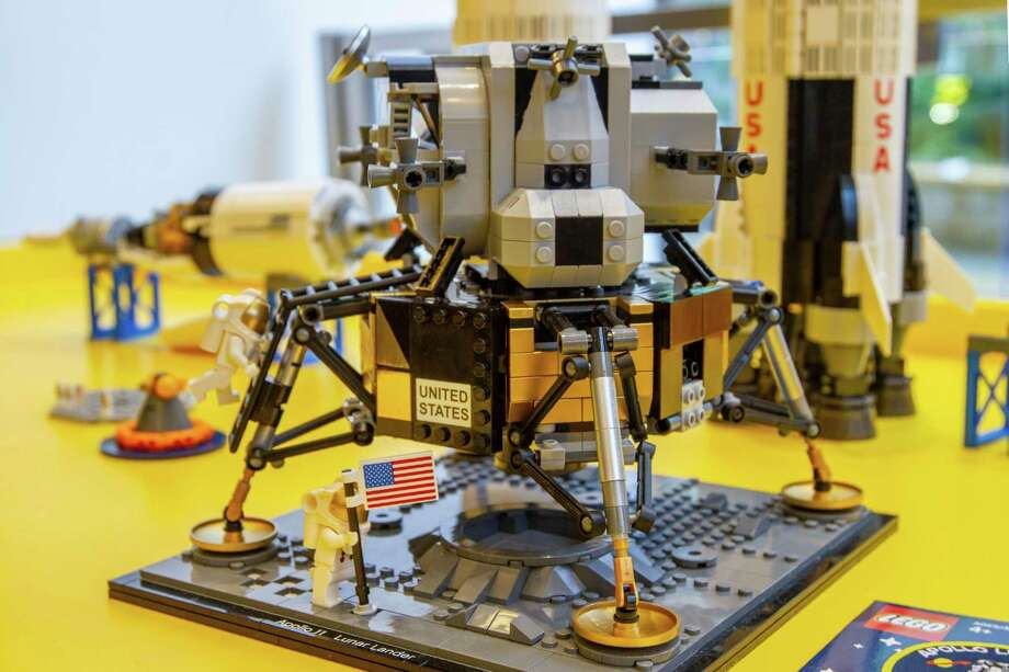 A Lego model of the Apollo 11 lunar lander is displayed in the company's store in New York on Tuesday, June 18, 2019. Hundreds of millions of people were riveted when Apollo 11 landed on the moon on July 20, 1969. Naturally, marketers jumped at the chance to sell products from cars and televisions, to cereal and a once-obscure powdered drink called Tang. They are at it again in 2019, as the 50th anniversary of the giant leap for mankind approaches. (AP Photo/Marshall Ritzel) Photo: Marshall Ritzel / AP