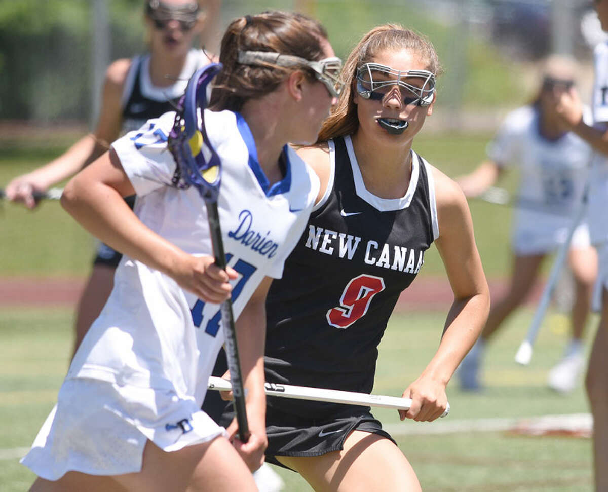 New Canaan senior co-captain Katelyn Sparks (9) defends against Darien's Sarah Jaques (17) during the CIAC Class L girls lacrosse final at Jonathan Law High School in Milford on Saturday, June 8, 2019. - Dave Stewart/Hearst Connecticut Media