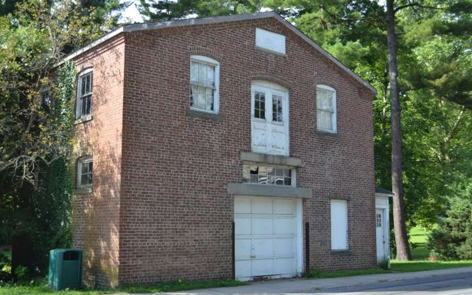 The garage at Richmond Hill Road and Mead Park, before the demolition sign was posted.— Wesley Orser photo