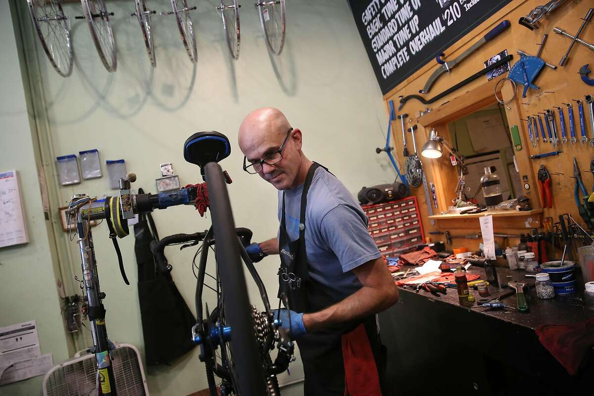 John McDonell, owner Market Street Cycles, works on a bike repair at Market Street Cycles on Monday, June 24, 2019 in San Francisco, Calif.