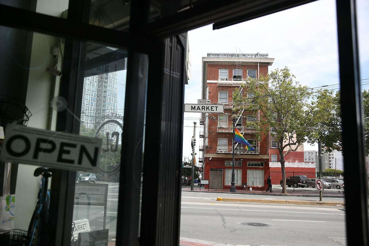 The Civic Center Navigation Center is seen through the doorway of Market Street Cycles on Monday, June 24, 2019 in San Francisco, Calif.