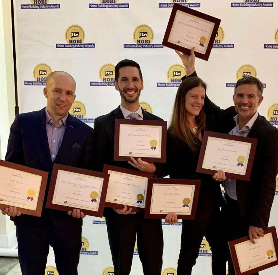 The Fore Group, the company Fotis Dulos owns, earned eight awards from the Home Builders Association of Connecticut in 2018. Fotis Dulos is on the right, with Michelle Troconis. Photo: Contributed Photo / Contributed