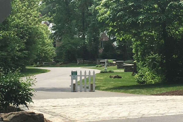 Outside Fotis Dulos' Jefferson Crossing residence in Farmington, Conn., on June 1, 2019. Dulos' estranged wife, Jennifer Dulos, went missing on May 24, 2019. Police questioned Fotis Dulos on May 31 and searched his house the following day. Photo: Dan Haar / Hearst Connecticut Media