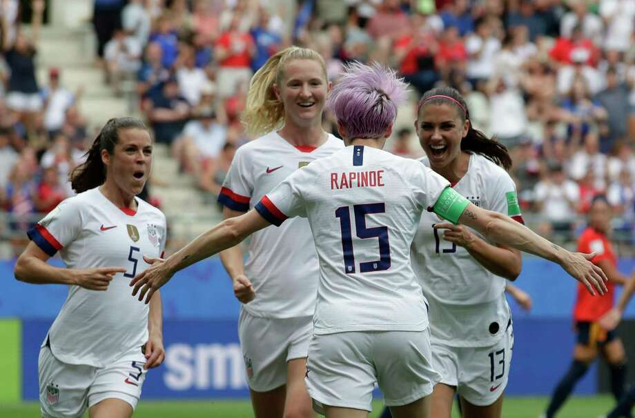 United States' Megan Rapinoe, front, celebrates with teammates after scoring the opening goal from a penalty kick during the Women's World Cup round of 16 soccer match between Spain and US at the Stade Auguste-Delaune in Reims, France, Monday, June 24, 2019. (AP Photo/Alessandra Tarantino) Photo: Alessandra Tarantino / Copyright 2019 The Associated Press. All rights reserved