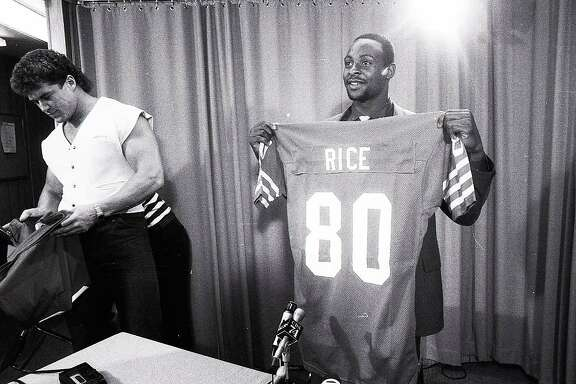 May 1,�1985:�Jerry�Rice�poses with his jersey, after being announced as the 49ers first round draft pick.