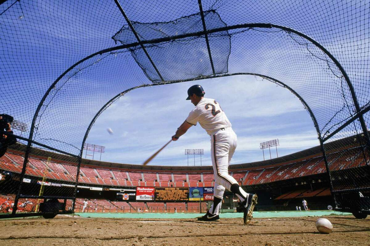 Will Clark of the San Francisco Giants hits during batting practice before a game in the 1989 season at Candlestick Park.
