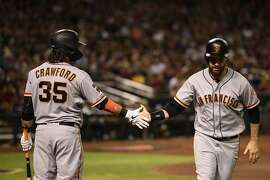 PHOENIX, ARIZONA - JUNE 22: Brandon Belt #9 of the San Francisco Giants is congratulated by Brandon Crawford #35 after scoring against the Arizona Diamondbacks during the third inning of the MLB game at Chase Field on June 22, 2019 in Phoenix, Arizona. (Photo by Jennifer Stewart/Getty Images)