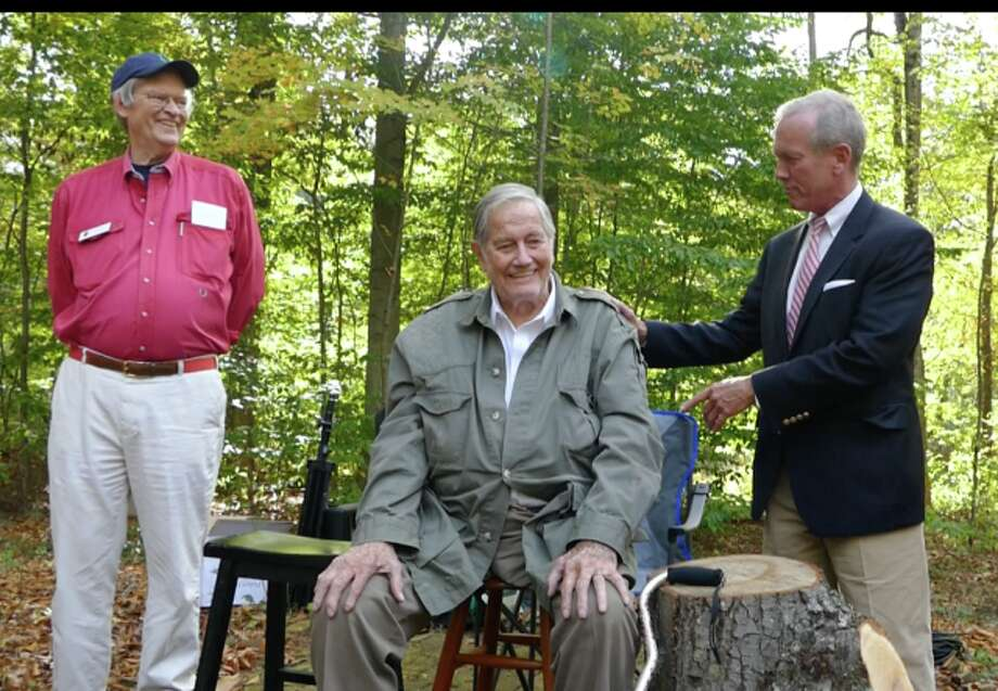 Selectman Nick Williams placed his hand on the one-time host of Mutual of Omaha's Wild Kingdom, Jim Fowler, and thanked him for his foresight. The President of the New Canaan Land Trust Art Berry, looked on. — Grace Duffield / Hearst Connecticut Media