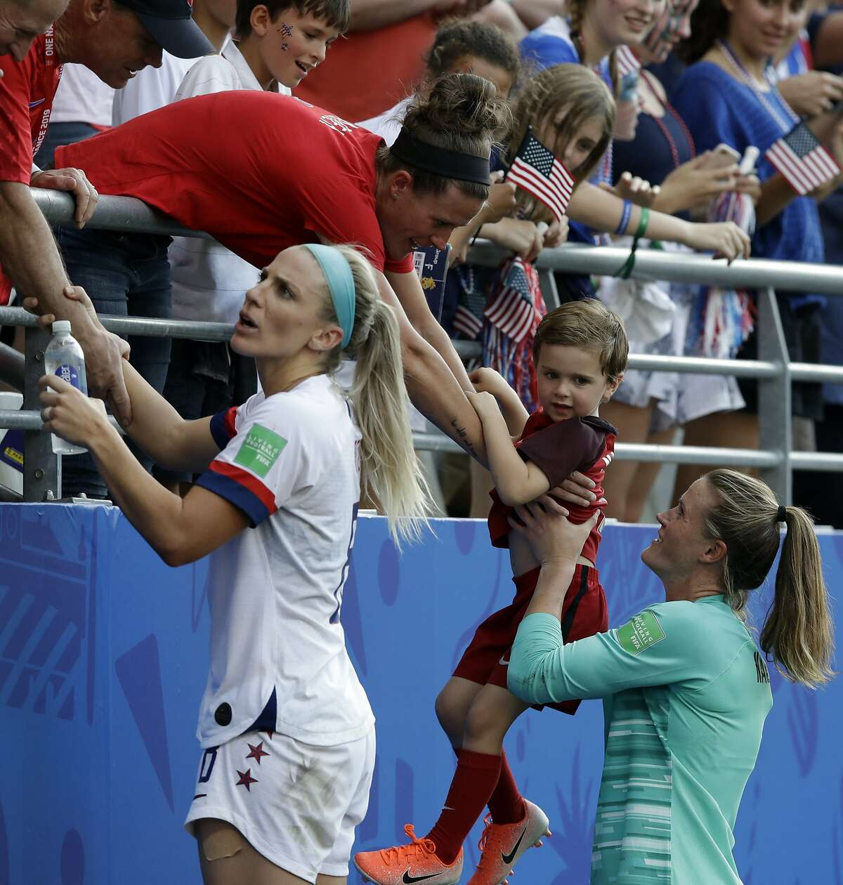 United States players celebrates with supporters at the end of the Women's World Cup round of 16 soccer match between Spain and US at the Stade Auguste-Delaune in Reims, France, Monday, June 24, 2019. US beat Spain 2-1. (AP Photo/Alessandra Tarantino)