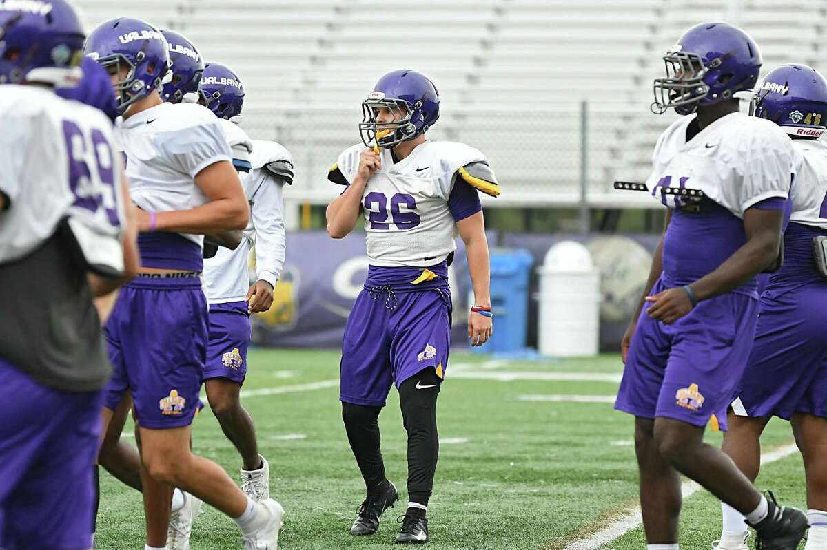 UAlbany football player Tyler Harwood, center, practices with his team on Thursday, Oct. 4, 2018 in Albany, N.Y. Harwood eats a vegan/plant-based diet. (Lori Van Buren/Times Union)