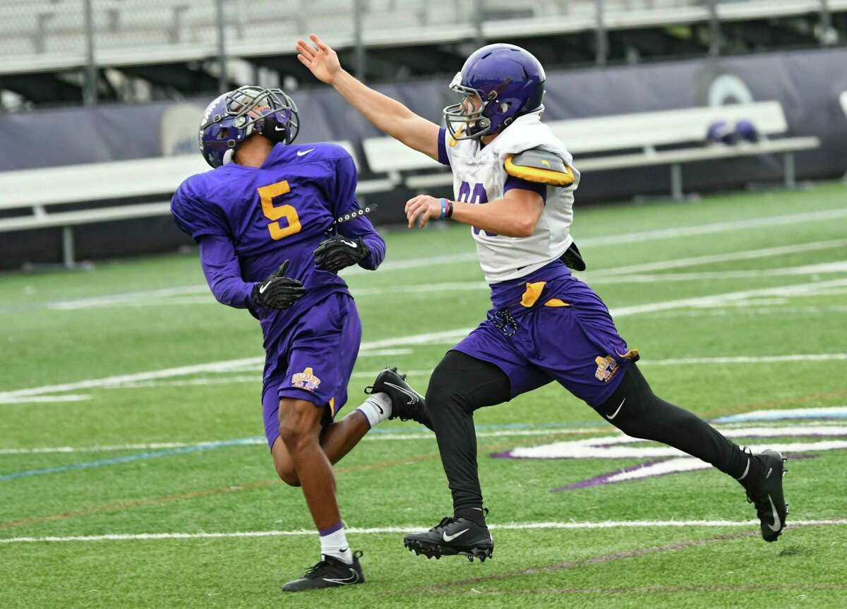 UAlbany football player Tyler Harwood, right, covers Dev Holmes as the team practices on Thursday, Oct. 4, 2018 in Albany, N.Y. Harwood eats a vegan/plant-based diet. (Lori Van Buren/Times Union)
