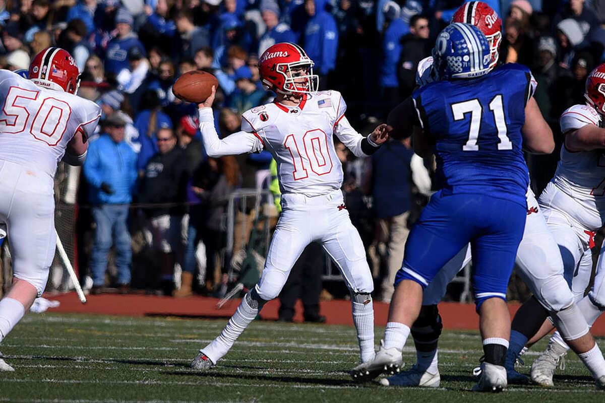 New Canaan quarterback Drew Pyne throws a pass during the Turkey Bowl at Dunning Field in November. - Dave Stewart photo