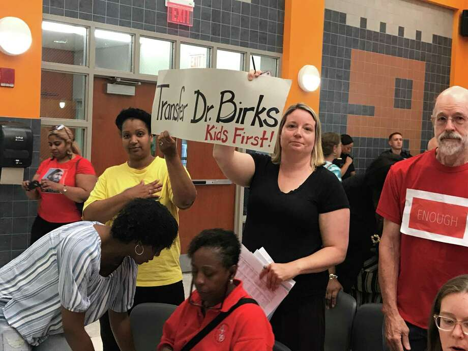 Community members Valerie Horsley and Maria Harris hold a sign in opposition to Superintendent of Schools Carol Birks on June 24, 2019. Photo: Brian Zahn/Hearst Connecticut Media