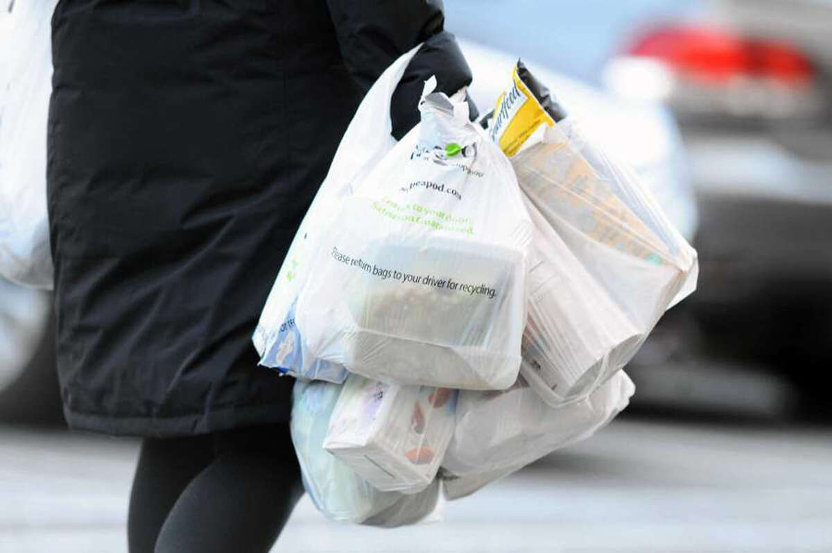 Customers exit Stop & Shop with plastic bags inside the Ridgeway Shopping Center between Summer St. and Bedford St. in Stamford, Conn. on Monday, March 26, 2018. Stamford lawmakers are attempting to ban single-use plastic bags. Michael Cummo / Hearst Connecticut Media