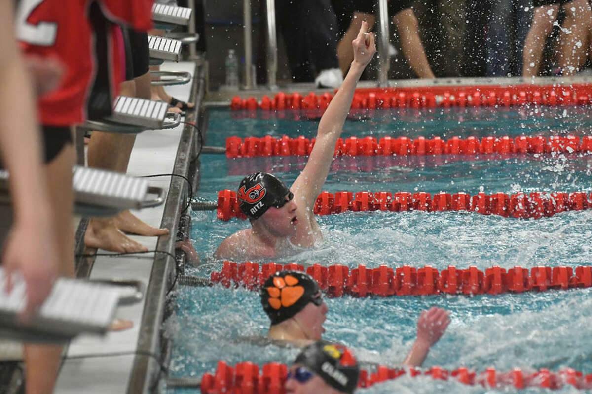 Jake Ritz of New Canaan after the Rams won the 200-yard freestyle relay during the FCIAC Swimming Championships held on Thursday February 28, 2019 at Greenwich High School. - Gregory Vasil/Hearst Connecticut Media