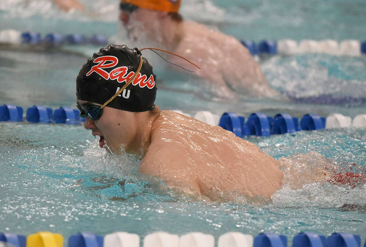 New Canaan senior co-captain Daniel Lu competes in the 100 breaststroke during the Rams' Senior Day win over Danbury at the New Canaan YMCA on Wednesday, Feb. 6. - Dave Stewart/Hearst Connecticut Media
