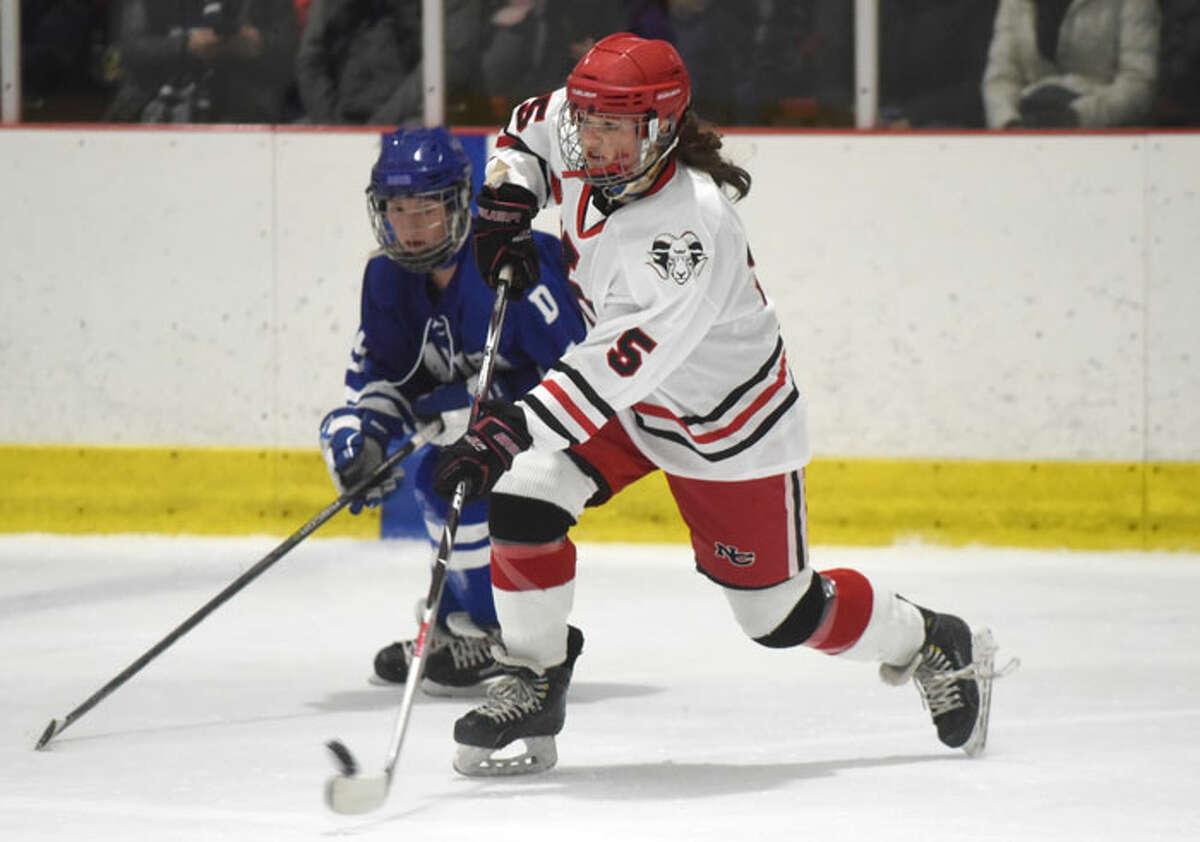New Canaan sophomore Anika Curri (5) takes a shot. - Dave Stewart/Hearst Connecticut Media photo