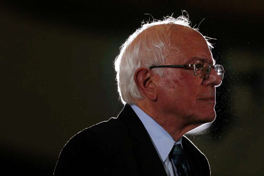 FILE -- Sen. Bernie Sanders (I-Vt.), a Democratic presidenti-al hopef-ul, speaks at the Poor People's Moral Action Congress presidential forum hosted by the Poor People?s Campaign at Trinity Washington University in Washington, on June 17, 2019. Sanders, along with Reps. Ilhan Omar (D-Mi-nn.) and Prami-la Jayapal (D-Wa-sh.), introduced legislation on Monday, June 24, 2019, to eliminate all of the country?s student debt while transforming the nation?s higher education system, escalating the policy battle to win the support of the Democratic Party?s left flank. (Tom Brenner/The New York Times) Photo: TOM BRENNER / NYTNS