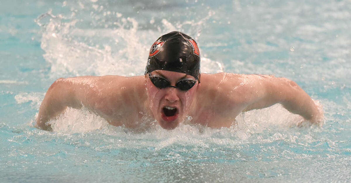 New Canaan senior co-captain Jake Ritz competes in the 100 butterfly during the Rams' Senior Day win over at the Danbury New Canaan YMCA on Wednesday, Feb. 6. - Dave Stewart/Hearst Connecticut Media