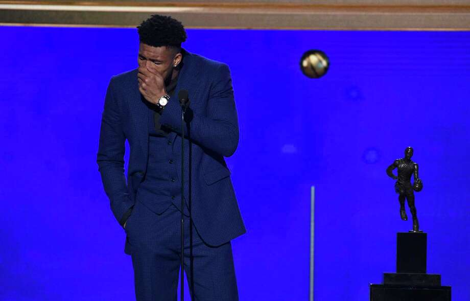 NBA player Giannis Antetokounmpo, of the Milwaukee Bucks, reacts as he accepts the most valuable player award at the NBA Awards on Monday, June 24, 2019, at the Barker Hangar in Santa Monica, Calif. (Photo by Richard Shotwell/Invision/AP) Photo: Chris Pizzello, Associated Press / Invision
