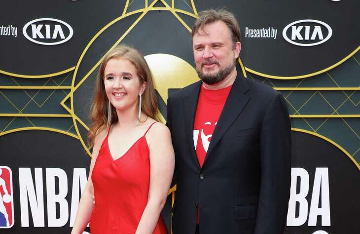 Rockets GM Daryl Morey and his daughter Karen walk the red carpert before the NBA Awards ceremony Monday.
