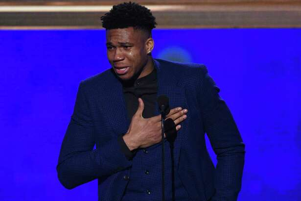 NBA player Giannis Antetokounmpo, of the Milwaukee Bucks, reacts as he accepts the most valuable player award at the NBA Awards on Monday, June 24, 2019, at the Barker Hangar in Santa Monica, Calif. (Photo by Richard Shotwell/Invision/AP)