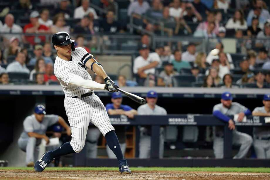 NEW YORK, NEW YORK - JUNE 24: Giancarlo Stanton #27 of the New York Yankees hits a three run home run against the Toronto Blue Jays in the sixth inning at Yankee Stadium on June 24, 2019 in New York City. (Photo by Michael Owens/Getty Images) Photo: Michael Owens / 2019 Getty Images