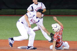 Gillespie's Kaden Lemon (right) is tagged out stealing by Alton second baseman Gage Booten while shortstop Jayce Maag smiles with approval of the out in Alton's 3-0 victory Monday night at SIUE's Roy Lee Field in Edwardsville.