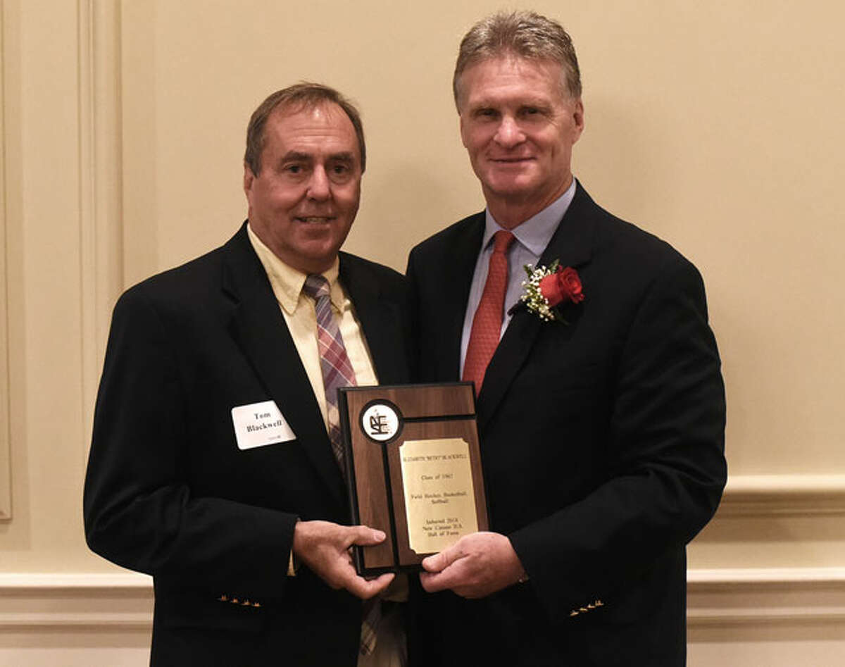 Tom Blackwell, who accepted the Hall of Fame award for his sister, Betsy Blackwell, with NCHS athletic director Jay Egan. - Dave Stewart photo