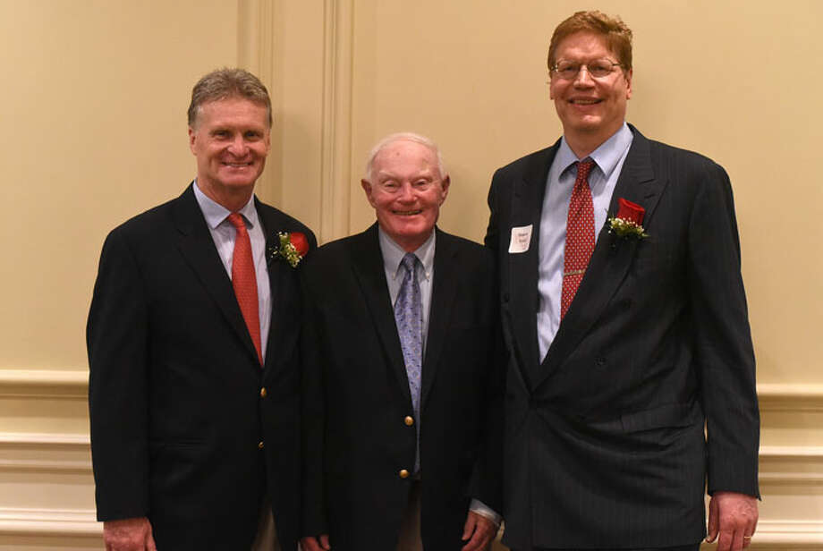 New Canaan High School athletic director Jay Egan, former Rams' basketball coach Don Usher, and Monroe Trout, who was inducted into the NCHS Sports Hall of Fame last Friday at the Woodway Country Club. — Dave Stewart photo