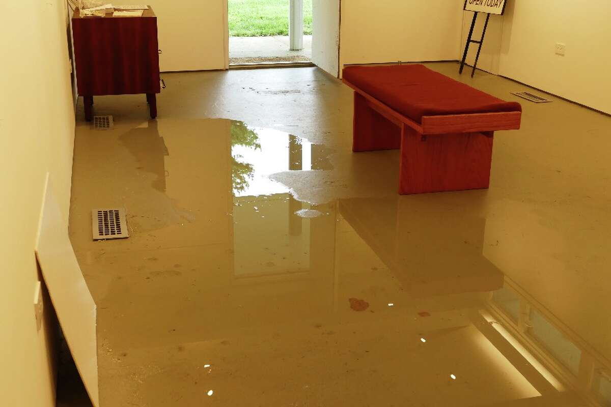 Puddles of water on interior floor.