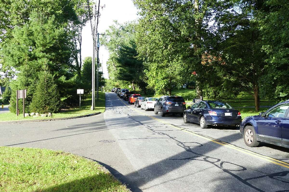 Cars heading west on Gerdes Road, with the State Highway garage entrance at left, are backed up from the traffic light at South Avenue.