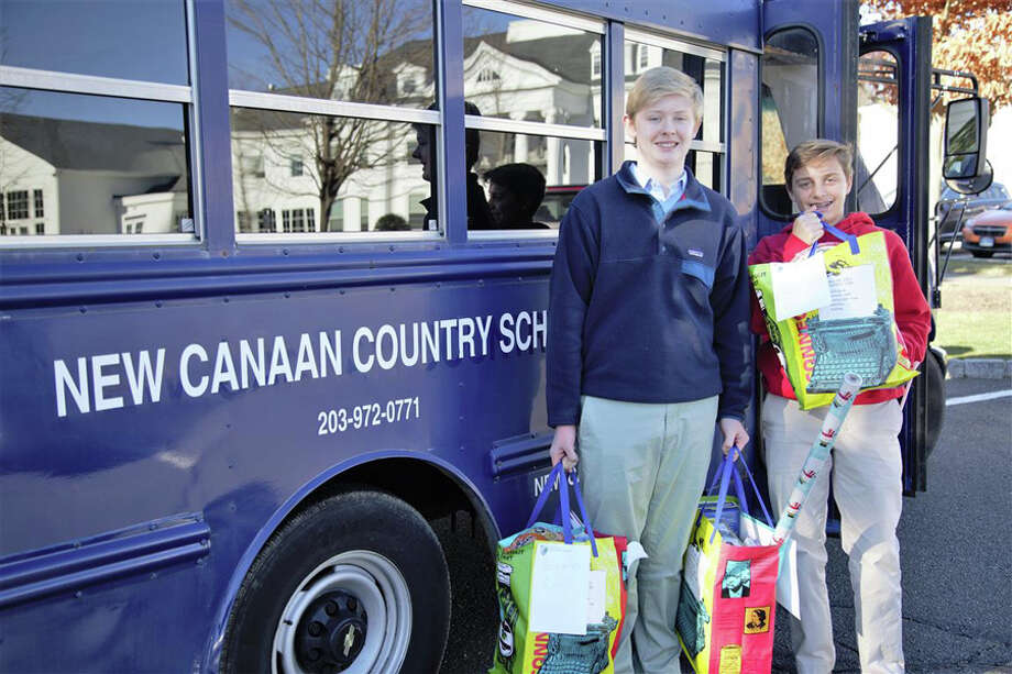 "New Canaan Country School ninth graders delivered ""Dove bags"" of food for 43 local families in need, Dec. 19. Working in teams led by ninth grade Teacher Elizabeth Carroll and captained by Amitav Nott and Bridget Keogh, both of New Canaan, and Gigi Morgan of Darien, the 38 students gathered, packed, recorded and transported the collected items to Person-to-Person, a non-profit organization, located in Darien and Norwalk. The food was donated by students in the school's Middle (Grades 5 & 6) and Upper (Grades 7-9) divisions."
