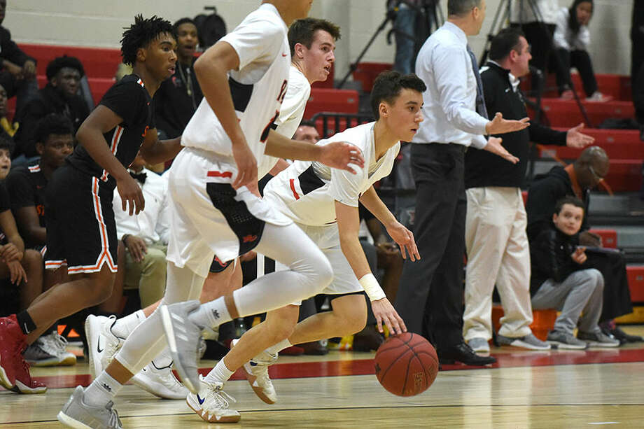 New Canaan's Ben Sarda and the Rams break out during a win over Stamford a NCHS on January 10. — Dave Stewart/Hearst Connecticut Media photo