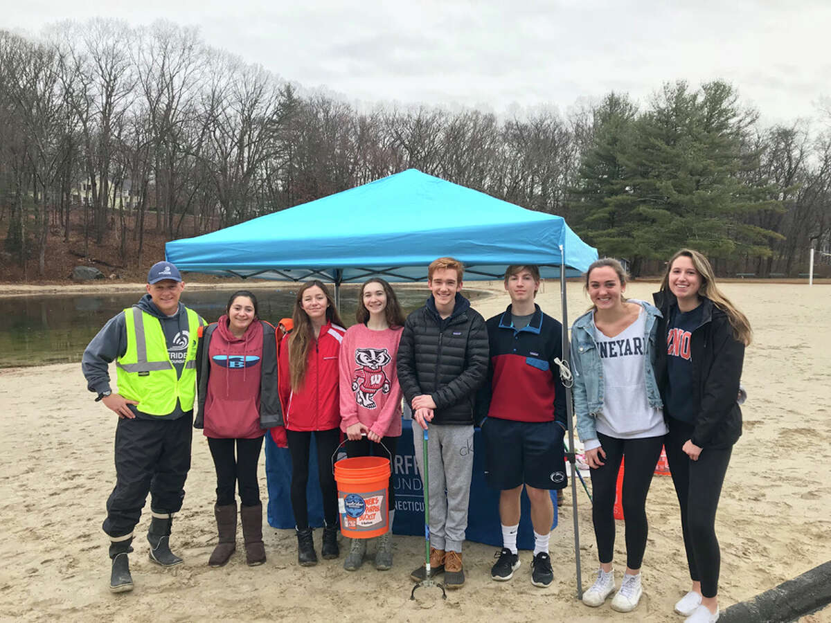 A volunteer cleanup crew recently collected trash, and recycables at the Five Mile River by Kiwanis Park in New Canaan. Jack Egan, left, of Surfrider Foundation and volunteers, Caroline Tuffy, Mary Holtam, Alexandra Harte, Andrew Jameson, Ben Thorsheim, Charlotte Smith, and Alex Bussan worked together to clean up garbage at the Five Mile River by Kiwanis Park Dec. 15.