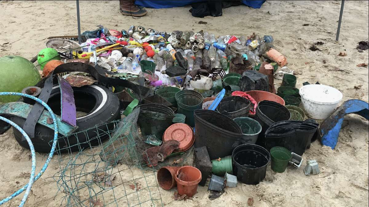 Garbage along the Five Mile River by Kiwanis Park, where Planet New Canaan, with the help of Surfrider Foundation, organized volunteers to clean up the area on Dec. 15.