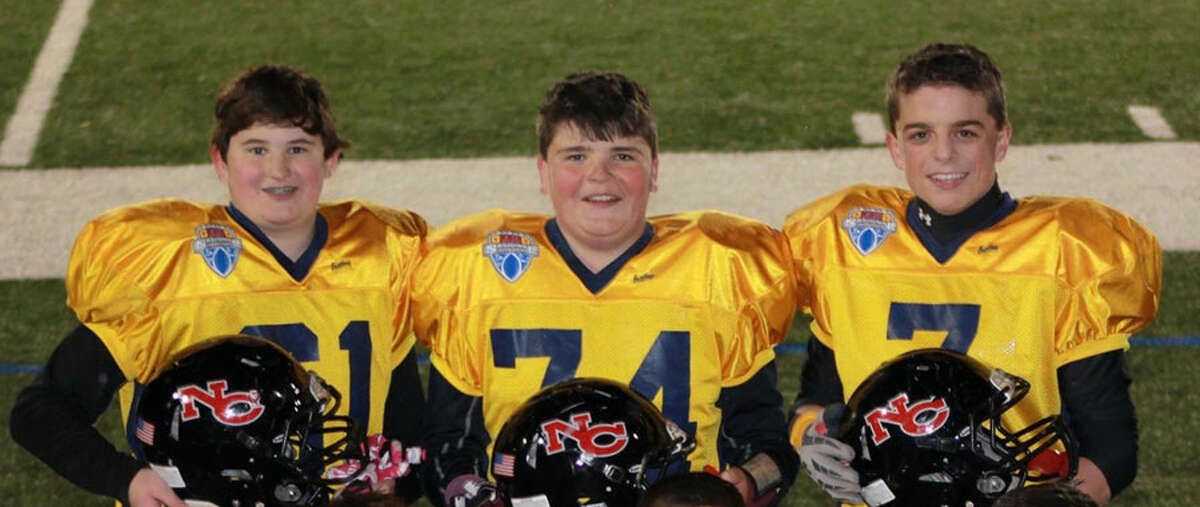 New Canaan's Jack Stewart, Jack Conley and Garrett Braden in their Football University uniforms during the seventh grade. The three players just finished their senior seasons at NCHS and signed their National Letters of Intent on Wed., Dec. 19.