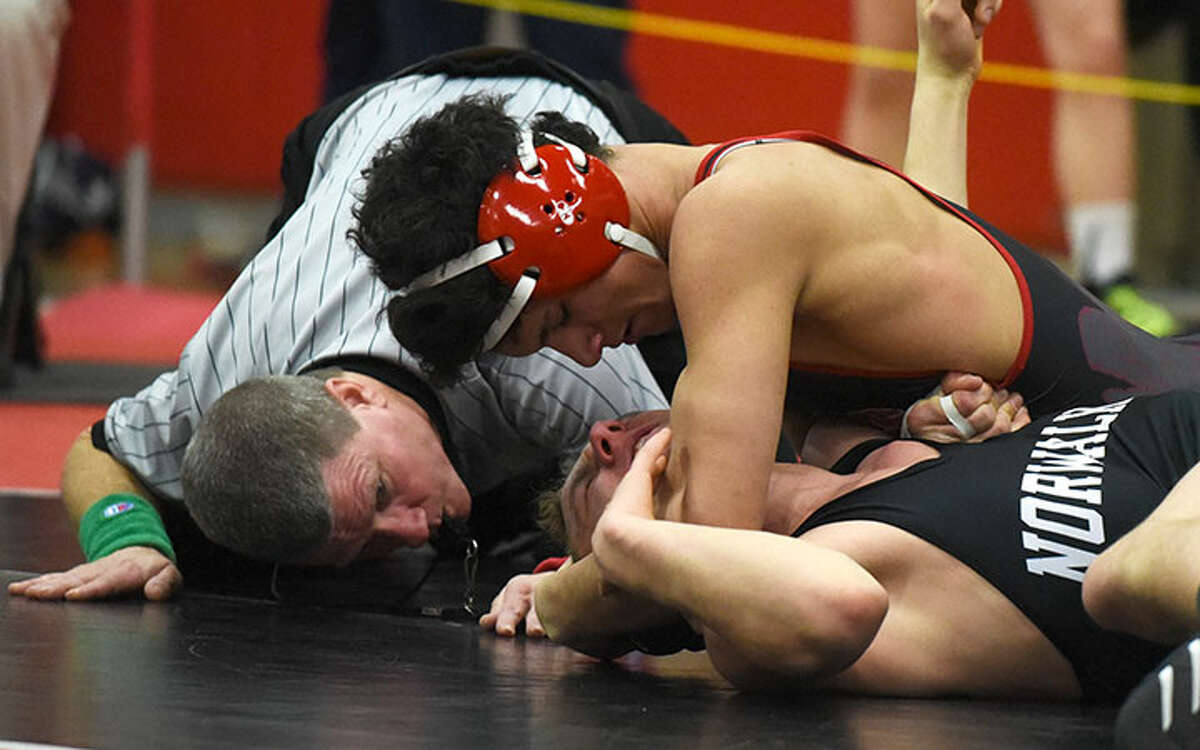 New Canaan sophomore Tyler Sung went 4-0 with three pinfalls en route to a Class L championship at 138 pounds last season in Bristol. - Dave Stewart photo